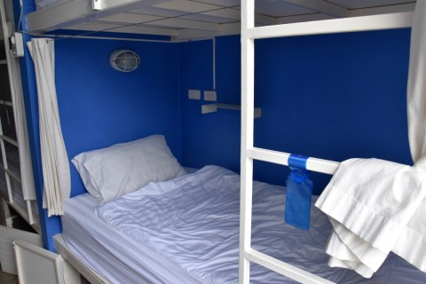 Well kitted out dorm beds.