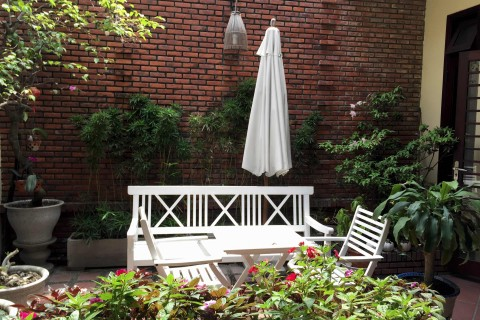 Settle into the courtyard at Orchids Homestay.