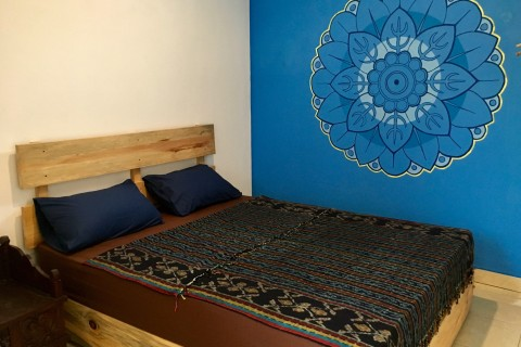 Each room has a soothing feature wall with a mandala.