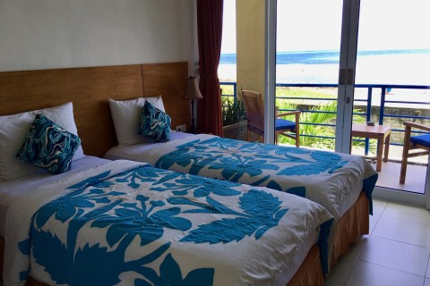 Bedspreads match the ocean.