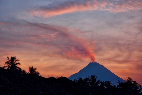 Smouldering Merapi from Borobudur.