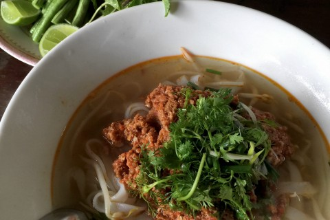 You'll find this khao soi at the shop on the main road across from Wat Senesoukharam.