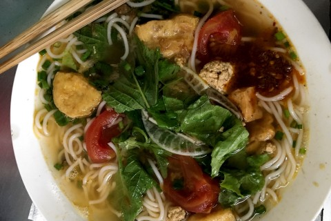 Bun rieu in all its steaming and pungent glory.