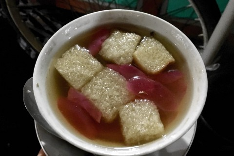 "Ronde, a sweet ""drink"" served in a bowl featuring balls of peanut-stuffed, glutinous rice and palm fruit in a warm gingery soup."