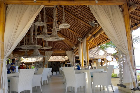 Start on the beach, then dine here at Spice Beach Club.
