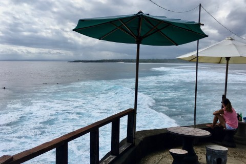 Enjoy the surf show at Mahana Point Warung and Bar.