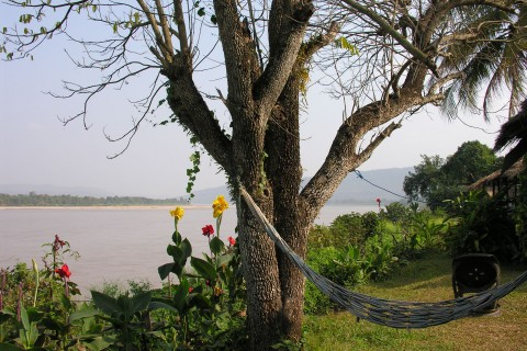 Put your feet up and watch the river slide by at Sangkhom.