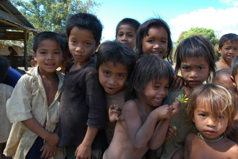 Kids hamming it up in a provincial village. Photo taken in or around Attapeu, Laos by Stuart McDonald.