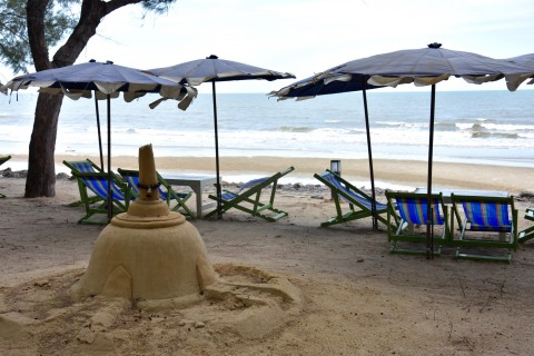 Build a sand chedi while here. Photo taken in or around Cha-am, Thailand by David Luekens.