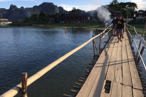 A simple bridge across the river. Photo taken in or around Vang Vieng, Laos by Cindy Fan.