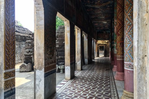 Shadowed walkways at Wat Nokor Bachay Photo taken in or around Kompong Cham, Cambodia by Nicky Sullivan.