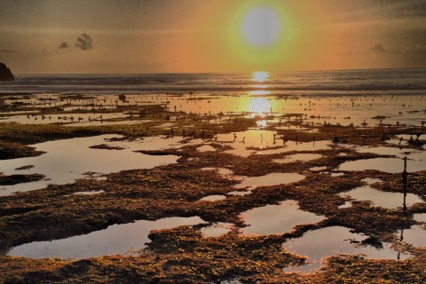 Be sure to catch a sunset. Photo taken in or around Nusa Ceningan, Indonesia by Stuart McDonald.