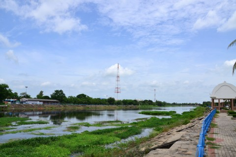 The wide Chakarat River flows south through central Phimai.