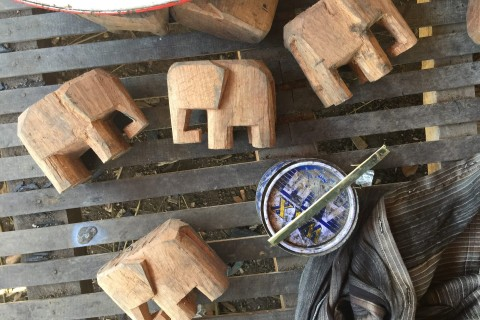 Takeaway pachyderms. Photo taken in or around Ban Nong Bueng woodcarving village, Champasak, Laos by Cindy Fan.