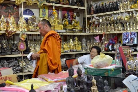 Many of the shoppers are monks. Photo taken in or around Phra Chan amulet market, Bangkok, Thailand by David Luekens.