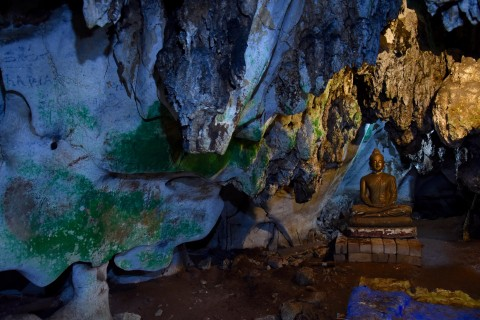 Buddha in a crevice. Photo taken in or around Wat Tham Khao Poon, Kanchanaburi, Thailand by David Luekens.
