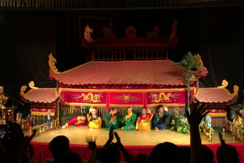 Puppeteers unmasked. Photo taken in or around Golden Dragon Water Puppet Theatre, Ho Chi Minh City, Vietnam by Cindy Fan.