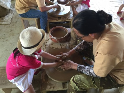 Get their hands dirty at the pottery village. Photo taken in or around Hoi An for families, Hoi An, Vietnam by Cindy Fan.