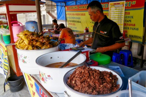 You won't go hungry on this street. Photo taken in or around Jalan Malioboro, Yogyakarta, Indonesia by Sally Arnold.