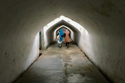 Strolling through the tunnels. Photo taken in or around Taman Sari and Sumur Gumuling (Water Palace and Underground Mosque), Yogyakarta, Indonesia by Sally Arnold.
