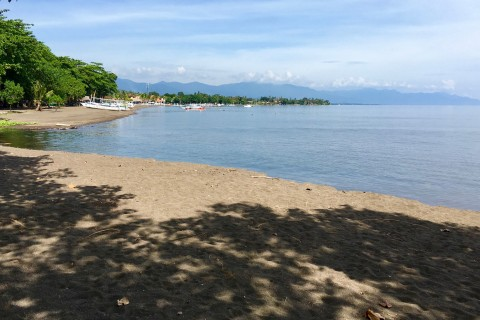 Not the most stunning beach by day. Photo taken in or around Beaches, Lovina, Indonesia by Sally Arnold.