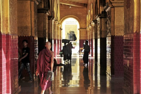 The atmosphere is part of the attraction. Photo taken in or around Mahamuni Paya, Mandalay, Burma_myanmar by Mark Ord.